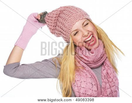 Portrait Of Cheerful Teenager Girl In Winter Hat And Scarf