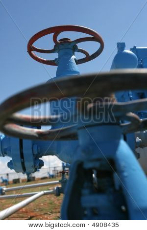 Two Blue Vertical Valves In Gas System
