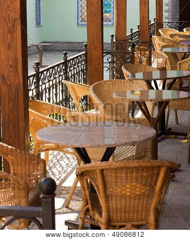 Empty Street Cafe With Wicker Chairs