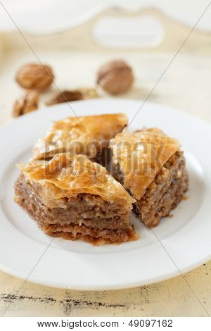 Baklava, delicious pastry dessert made with phyllo dough, nuts, butter, and sugar.
