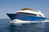 Large Luxury Motor Yacht Under Way At Sea
