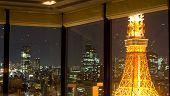View On Tokyo By Night Through Windows