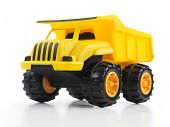 foto of dump  - Yellow toy dump truck isolated on white background - JPG