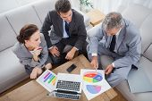 image of coworkers  - Business people analyzing diagrams together in cosy meeting room - JPG