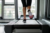 stock photo of treadmill  - Exercising On A Treadmill Woman Exercising in gym - JPG