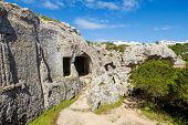 pic of morels  - Cala Morell Necropolis Caves in sunny day at Menorca - JPG