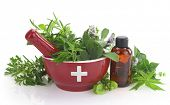 stock photo of naturopathy  - Mortar with medicine cross - JPG