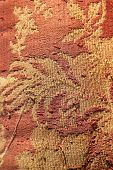picture of brocade  - Close up of a very old brocade red and golden flowers - JPG