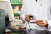 stock photo of barcode  - cropped view of pharmacist scanning medicine with barcode reader - JPG