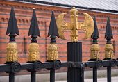 picture of tyranny  - A fence of heavy symbols of power - JPG