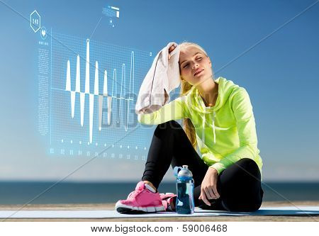 sport and lifestyle concept - woman resting after doing sports outdoors