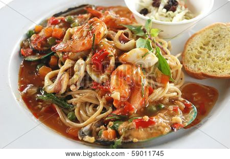 spaghetti sea food spicy and sour Asian sauce Thai fusion food