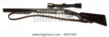 3 barreled rifle with scope and a strap