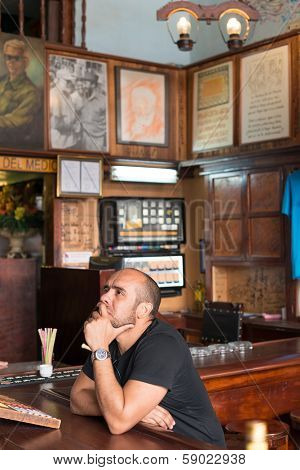 HAVANA,CUBA -JANUARY 20,2014:Tourist drinking at La Bodeguita del Medio.This restaurant was a favorite of Hemingway and also a big attraction for the almost 3 million tourists who visited Cuba in 2013