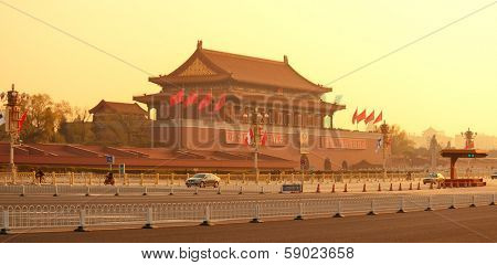 BEIJING, CHINA - APR 6: Tiananmen sunrise with street on April 6, 2013 in Beijing, China. Tiananmen is a famous monument in Beijing and serves as a national symbol.