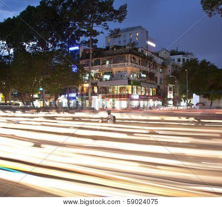 SAIGON - NOV 18, 2013: Road Traffic at evening on Nov 18, 2013 in Saigon (Ho Chi Minh City), Vietnam. Saigon is the largest city in Vietnam. Most popular mean of transport in Vietnam is a motorbike.