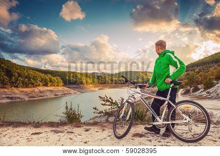 Young Man With Bike Enjoy With Beautiful Mountain Lake View