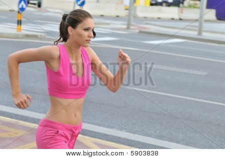 Young Person Running In City Road