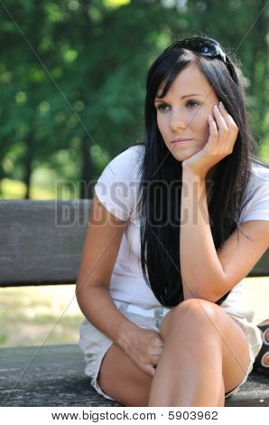 Young Pensive Woman Siting On Bench