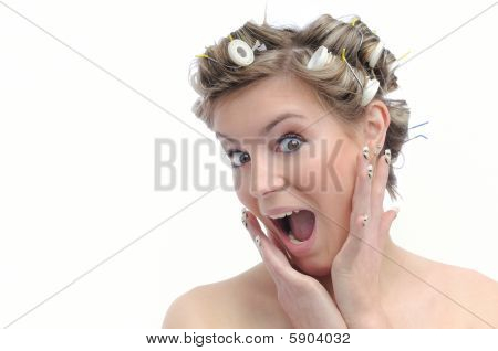 Young Beautiful Woman With Hair Rollers - Surprise