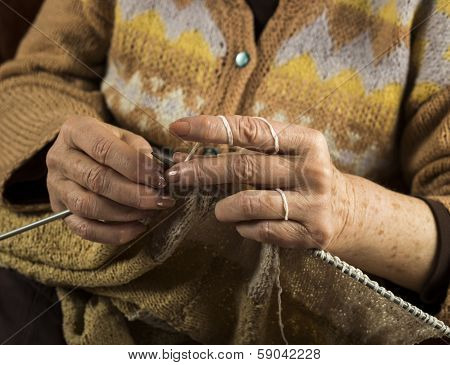 Hands Of An Older Woman Knitting Close Up