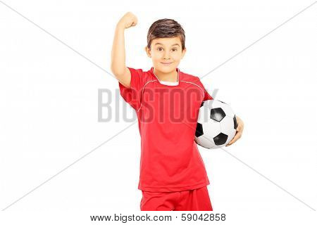 Young boy in sportswear holding soccer ball and gesturing with his hand, isolated on white background
