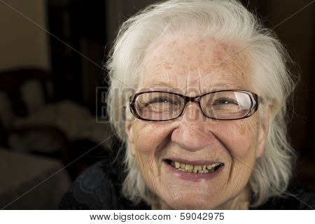Portrait Of An Older Woman With Glasses Smiling