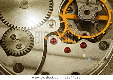 Clockwork details, pinions and wheels closeup