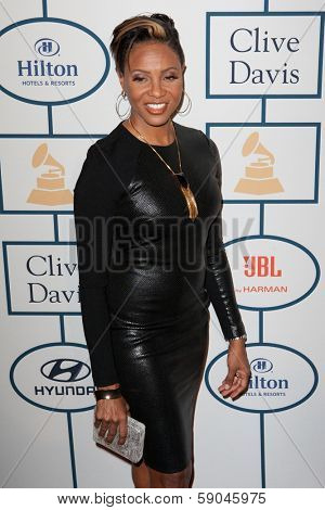BEVERLY HILLS, CA. - JANUARY 25: MC Lyte arrives at the Clive Davis and The Recording Academy annual Pre-GRAMMY Gala on January 25th 2014 at the Beverly Hilton in Beverly Hills, California.