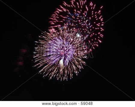 Two Colorful Starburst Firework Explosions