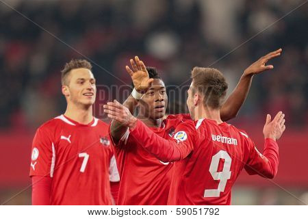 VIENNA,  AUSTRIA - MARCH 22 Andreas Weimann (#9 Austria) and David Alaba (#8 Austria) celebrate a goal during the world cup qualifier game on March 22, 2013 in Vienna, Austria.