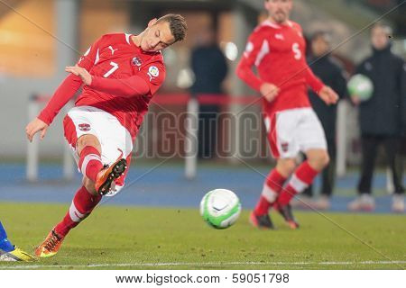 VIENNA,  AUSTRIA - MARCH 22 Marko Arnautovic (#7 Austria) kicks the ball during the world cup qualifier game on March 22, 2013 in Vienna, Austria.