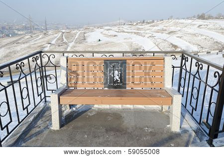 Krasnoyarsk, RU - Nov.9, 2012: Bench with coat of arms in November,9