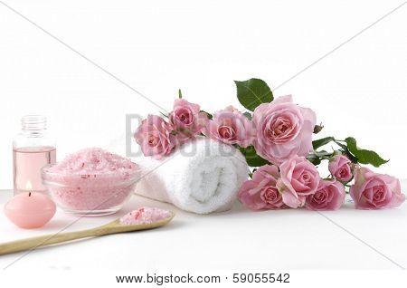 Spa sitting with rose ,salt in spoon, towel