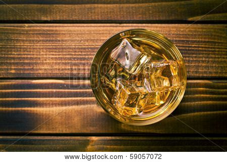 top view of whiskey in glass with ice