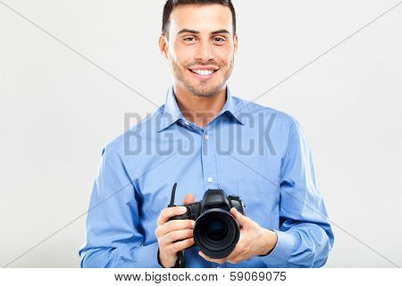 Smiling photographer using his camera