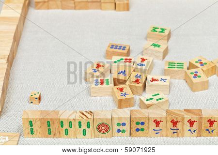Player Hand From Wooden Tiles In Mahjong Game