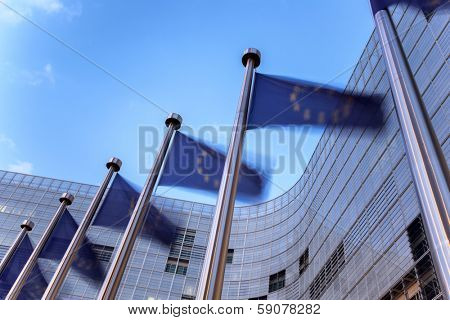 European union flags waving in front of building