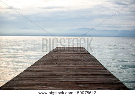 Desolate wooden sea dock in dawn