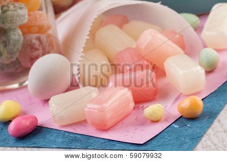 Old fashioned sweets (sugar-dusted pear drops) arranged in a random background