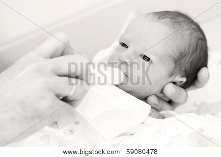 Cute Newborn Boy Eats
