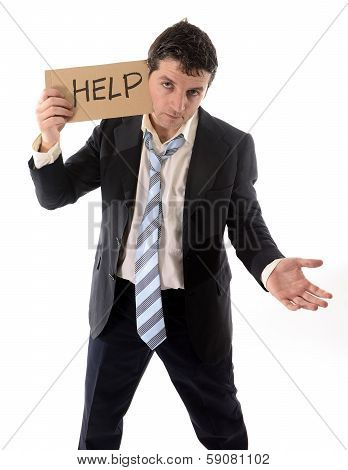 Stressed Business Man Holding Help Sign