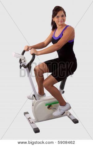Girl On Exercise Bike
