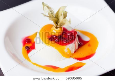 Coconut panna cotta with mango sauce and lingonberry jam