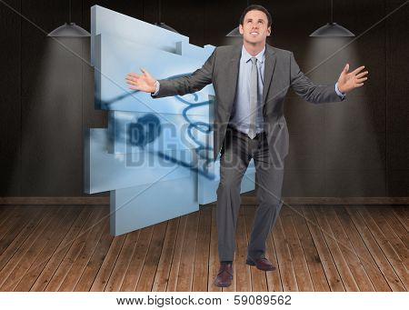 Businessman standing with arms out against dark room with floorboards
