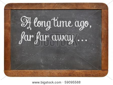 A long time ago, far, far away - a phrase for opening oral narratives, story or fairytale on a vintage blackboard, copy space below