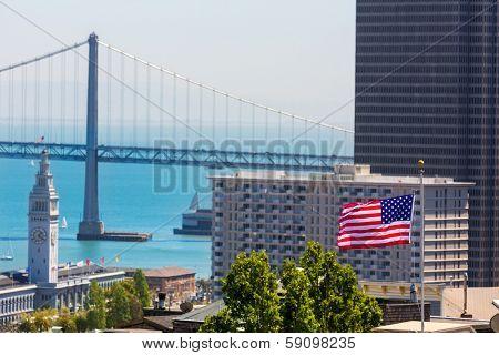 San Francisco USA American Flag Bay Bridge and Embarcadero Clock Tower from Telegraph Hill