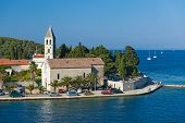 VIS, CROATIA - AUGUST 19, 2012: St. Juraj church, the first sight which greets visitors to on arriva