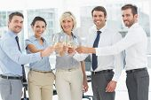 pic of office party  - Group of happy business team toasting with champagne in the office - JPG