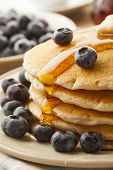 picture of buttermilk  - Homemade Buttermilk Pancakes with Blueberries and Syrup for Breakfast